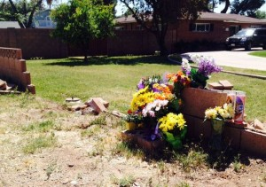 Flowers adorn the central Phoenix wall on April 8 that a car rammed through following a wreck involving teen drivers in late March. The victim, Octavio Grijalva Herrera, died from his injuries.(Photo: Randsom Rockliffe / The Republic)