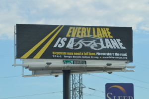 "TBAG had this billboard erected ""Every lane is a bike lane"""