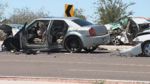 The three vehicles were badly damaged, including one that was crushed. (Source: KPHO/KTVK)